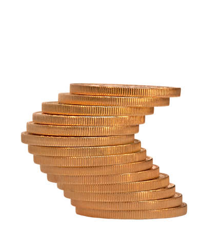 An uneasy balance in a stack of gold coins photo