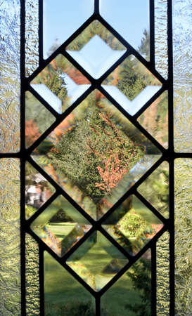 beveled: Fall view through a lead-paned, frosted glass window Stock Photo