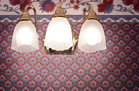 sconce: Brass light fixtures in traditional-style bathroom Stock Photo