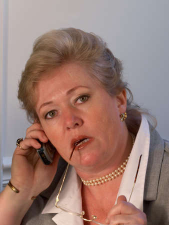 Mature businesswoman on the phone Stock Photo - 9940210