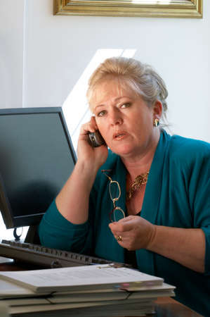 phone business: Mature businesswoman on the phone