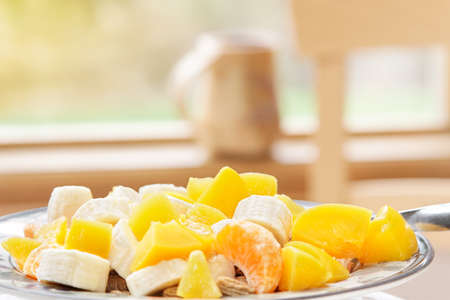 Fruit and cereal - sit & eat a healthy breakfast photo