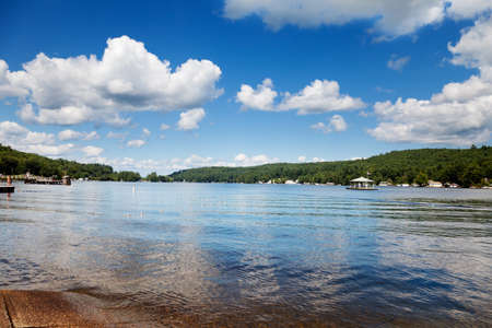 Boat ramp on Lake Winnipesaukee, New Hampshire on a sunny summer afternoon Stock Photo