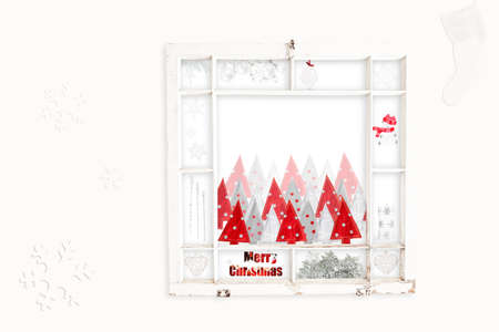 old items: Grungy old window frame with collage of red & white Christmas items. Clipping path for frame Stock Photo