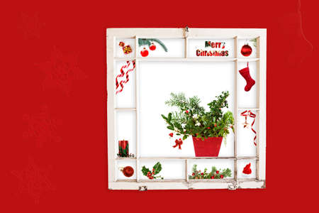 Grungy old window frame with collage of red Christmas items. Clipping path for frame photo
