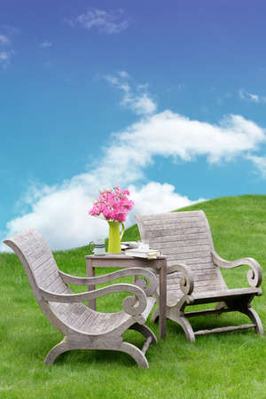 untreated: Wooden garden chairs in a surreal and peaceful spot Stock Photo