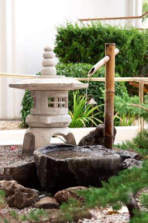 bamboo fountain: Japanese water garden outside a restaurant Stock Photo