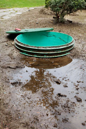 Leaks around the locking lids of a septic system photo