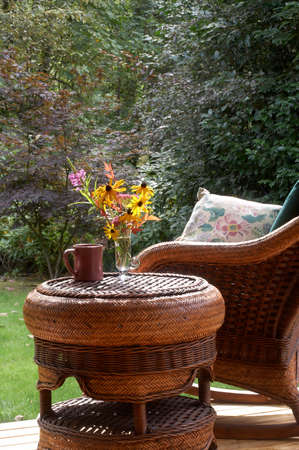 take a breather: Fall flowers, steaming mug, comfy chair... Stock Photo