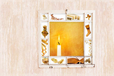 Grungy old window frame with collage of Christmas items on wood grain background. Clipping path for frame photo