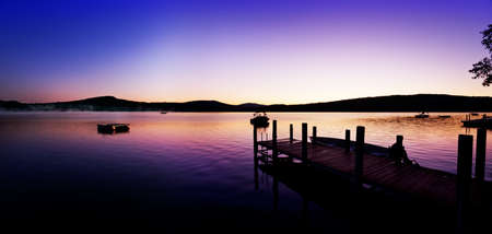 Vivid pre-sunrise colors over  New Hampshire dock and lake on a summer morning photo