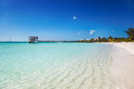 The calm shallow waters and white sands of Sapodilla Bay, Turks & Caicos