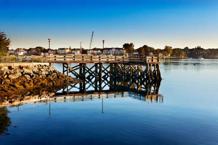 early summer: Wooden walkway juts into the swift Piscataqua River early on a summer morning, Portsmouth, New Hampshire