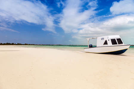 beached: A simple boat beached on a white sand beach, Providenciales, Turks and Caicos