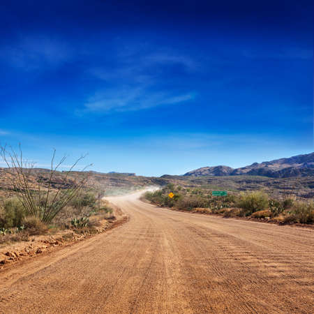 Pavement ends on the Apache Trail through the Tonto National Forest, Arizona photo