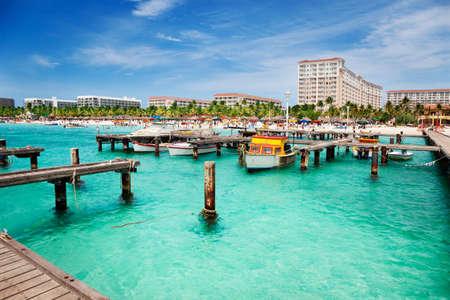 Dock on Palm Beach, Aruba on a sunny Spring afternoon