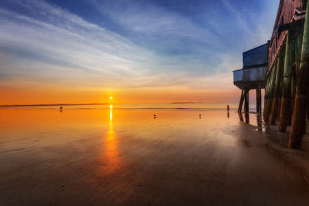 morning sun: Sun rises and lights the Old Orchard Beach, Maine, pier Stock Photo