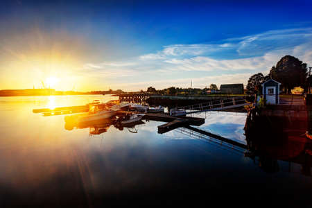 Sun rises over Kittery and the Portsmouth Naval Shipyard as seen from docks at Prescott Park, Portsmouth, New Hampshire photo