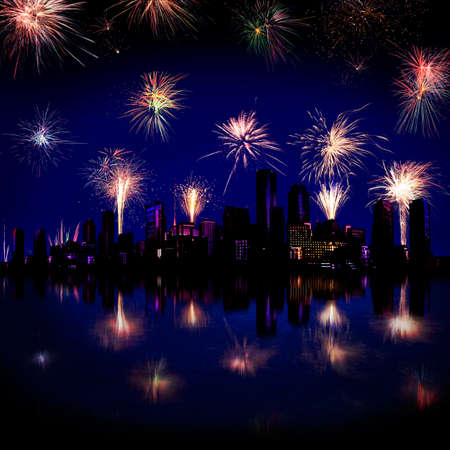 guy fawkes night: Bursts of fireworks over a waterfront city skyline