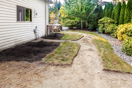 rennovation: After removing concrete path and existing plants, cutting out the new path and patio areas Stock Photo
