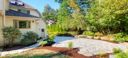 pavers: Path, patio and flowerbeds complete, with plants transplanted and mulched