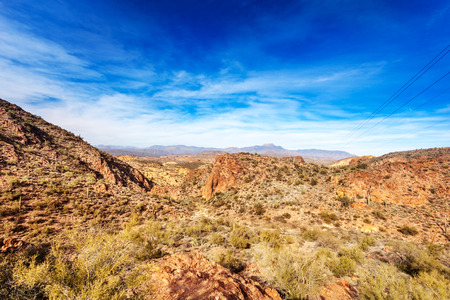 four peaks wilderness: Four Peaks Mountains in the distance behind the red rocky landscape running by the Apache Trail through the Tonto National Forest Arizona