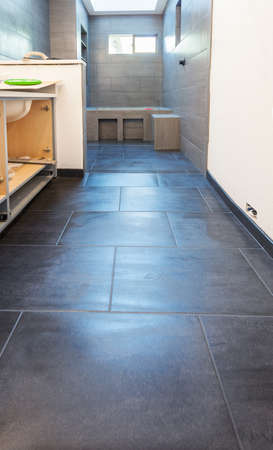 bathroom tile: Floor and wall tile in residential bathroom installed