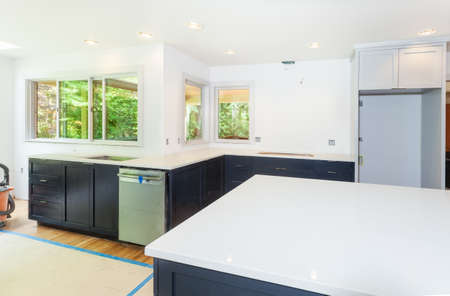 kitchen cabinets: Custom kitchen cabinets installed. Engineered quartz countertop installed.