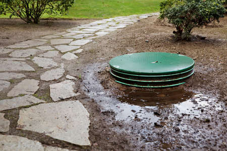 lids: Leaks around the locking lids of a septic systems tanks Stock Photo