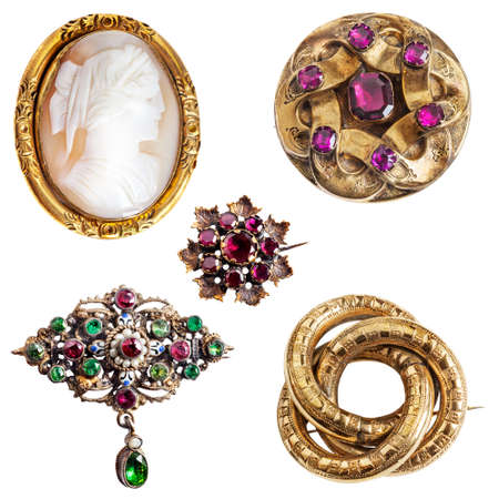 cameo: Antique and well worn gold jewelry - cameo,  amethyst, enamel, garnet and three-ring (lovers knot) gold brooches