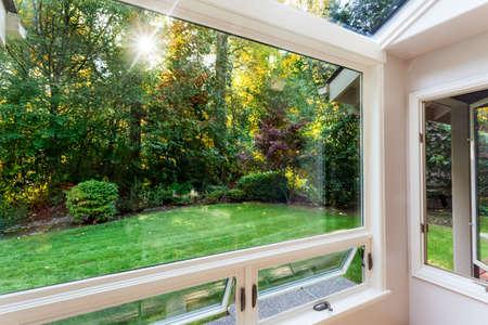 open windows: Open windows over the sun in a garden in early fall