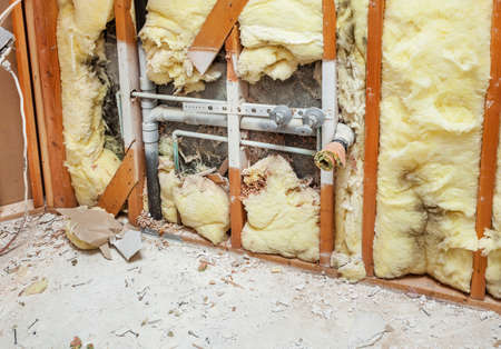 demolishing: Demolishing a residential bathroom at the beginning of a remodeling project