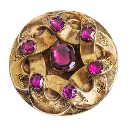 decades: Antique amethyst and carved gold brooch, worn and scraped by decades of use Stock Photo