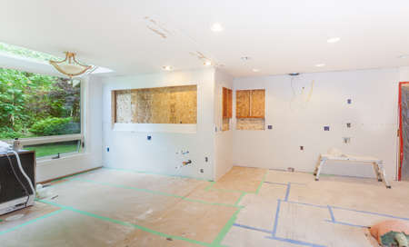 kitchen remodelling: Drywall screwed into place over new framing for windows