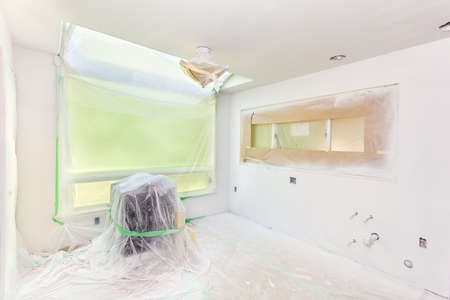 primer: Kitchen remodel: painters plastic covers everything not to be sprayed with primer