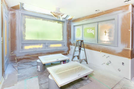 drop ceiling: Paper and plastic masking for spray painting of kitchen during a remodel