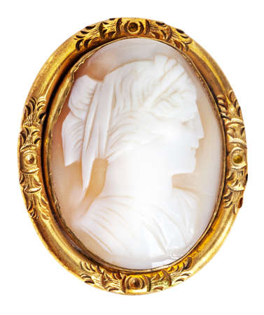 brooch: Antique and well worn gold cameo brooch Stock Photo