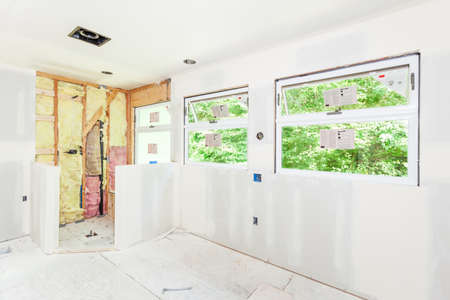 drywall: Drywall seams have been taped and smoothed with mud (spackle)