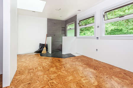 flooring cork: Cork tile floor installed and swept clean Stock Photo