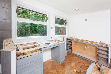 balsa: Balsa wood template for engineered stone countertops laid over cabinet tops Stock Photo