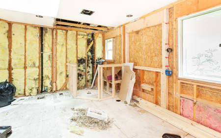 shower stall: Header and framing for new window openings and shower stall bench and pony walls