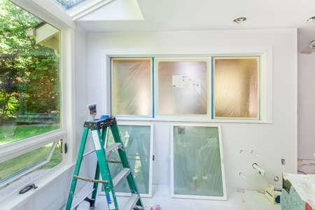 priming brush: Kitchen window masked for painting Stock Photo