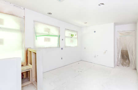 drywall: Starting the painting process by priming the textured drywall