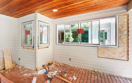 remodel: Adding windows during a kitchen remodel - installing into framed holes Stock Photo