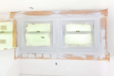 casing paper: Trim around windows masked and painted light gray