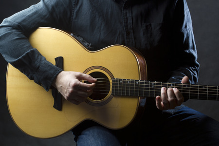 riff: Playing acoustic guitar Stock Photo