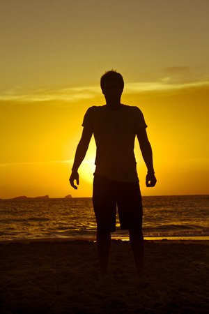 Man in front of the sunset, Cala Conta, Ibiza Stock Photo