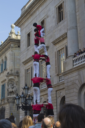 Barcelona, Catalonia, Spain - Februrary, 13 2011: Local festivities in Barcelona. The group of castellers called Castellers del Poble Sec; are building a human castle, a beautiful catalan tradition. Editorial