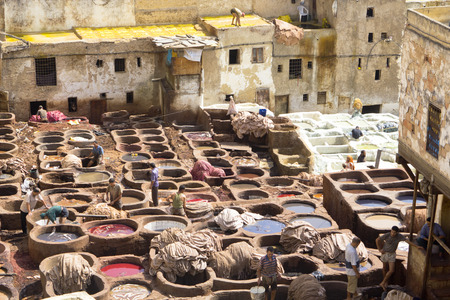 Fes,Morocco, 15th July 2012. People working in the famous tannery complex of Fes in foul smelling conditions. All natural ancient process. Editorial
