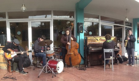 A Jazz quintet formed by a guitaris, piano man, bass, saxophone and a drummer is playing in Sitges, in the mediterranean coast, Catalonia, Spain.